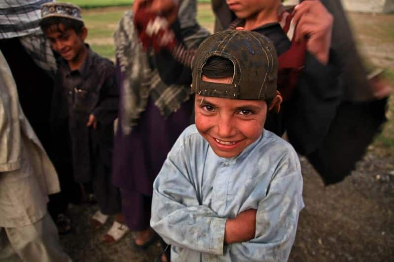 National middle-child day,                 afghani child laughing