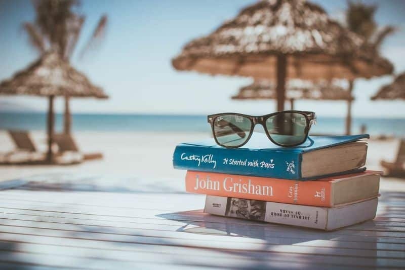 National sunglasses day,                 books reading beach